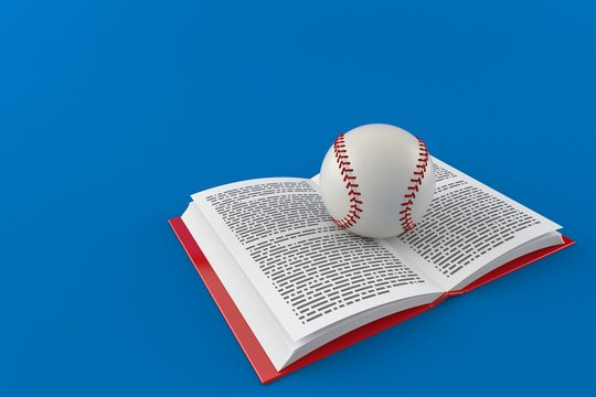 Baseball ball on open book