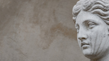 Ancient statue of sensual Italian renaissance era woman with long neck and curly hairs, Potsdam, Germany, details, closeup