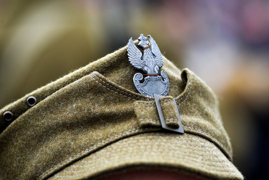 Eagle, Poland's emblem on the cap of a soldier from WWII during historical reconstruction.