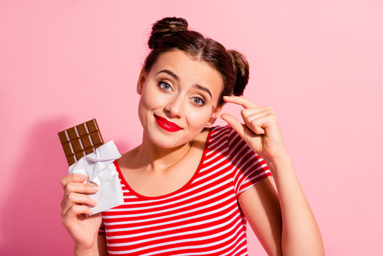 Close-up portrait of her she nice cute charming attractive lovely winsome funny girl wearing striped t-shirt holding in hands begging favorite desirable dessert isolated over pink pastel background