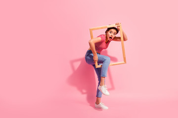 Full length body size view of her she nice cute charming attractive glamorous worried girl in casual striped t-shirt jeans trying to escape break rules borders life isolated over pink background