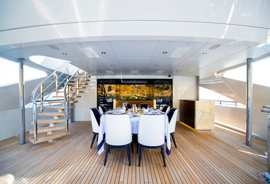 Luxury big yacht  deck with served table