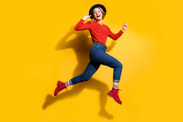 Profile side full length body size view of her she nice attractive lovely fascinating fashionable cheerful cheery girl having fun running isolated over bright vivid shine orange background Wall mural