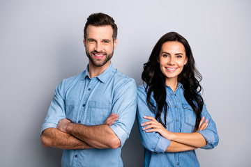 Portrait of charming charismatic freelancers entrepreneurs ready to solve business work problems take decisions. Wearing blue denim jackets isolated on ashy-gray background Wall mural