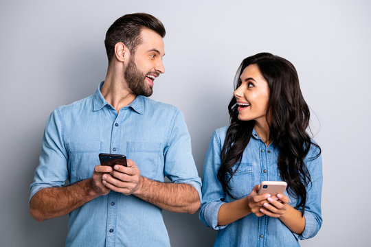 Close up photo amazing she her he him his lady guy telephone smart phone hands arms read reader news look interest eyes wear casual jeans denim shirts outfit clothes isolated light grey background