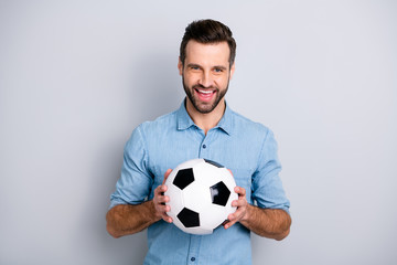 Close up photo macho he him his guy hold football white black leather ball watch match game true fan laugh laughter amazed wear casual jeans denim shirts outfit clothes isolated light grey background