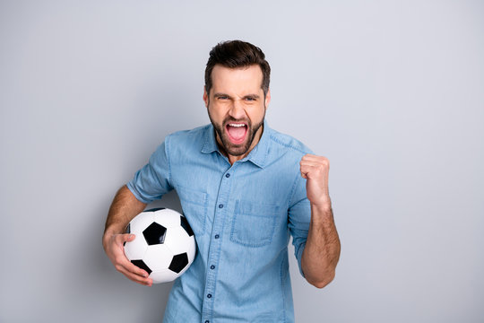 Close up photo macho he him his gentleman guy hold football leather ball watch match game true fan yelling loud amazed wear casual jeans denim shirts outfit clothes isolated light grey background
