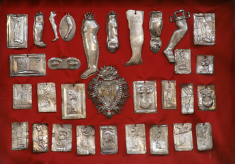 Silver votive offerings to Our Lady in the Church of Our Lady of the Snows in Pupnat, Korcula island, Croatia