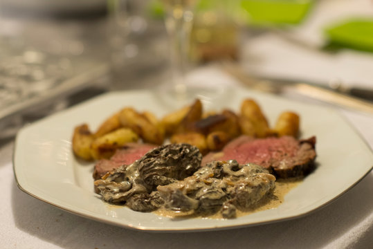 Beef tenderloin, morels and ratte potatoes for christmas diner. French speciality for festive Christmas celebration.