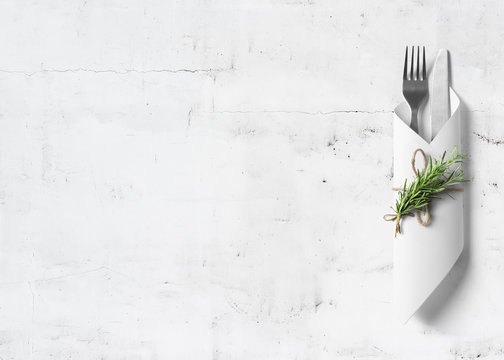 Cutlery with rosemary on marble background