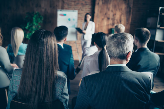 Audience of nice chic classy elegant stylish sharks listening to report strategy top management planning sales finance profit corporate at industrial loft interior work place space