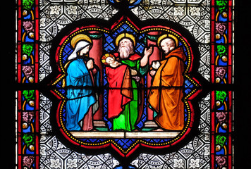Fotobehang Bedehuis Presentation in the Temple, stained glass window in the Basilica of Saint Clotilde in Paris, France