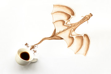Espresso cup with hand drawing dragon. Coffee art or creative concept. Top view