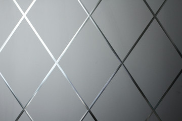 Rhombus background. Gray geometric background of rhombuses and glass. Glass gray background. Copy space for your text