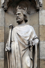 Saint Clovis, the first king of the Franks, statue on the portal of the Basilica of Saint Clotilde in Paris, France