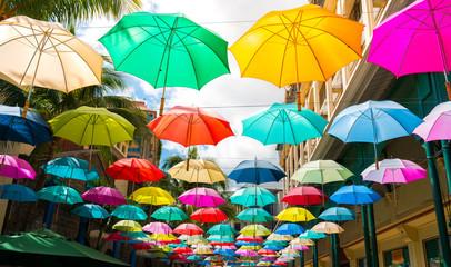 multicolored umbrellas in le caudan waterfront, port louis capital of mauritius