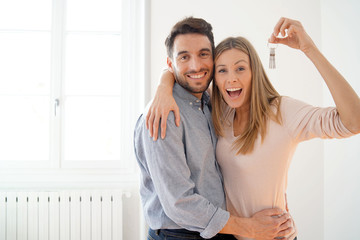 Happy couple with keys to new home