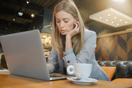Saleswoman preparing sales pitch on work trip