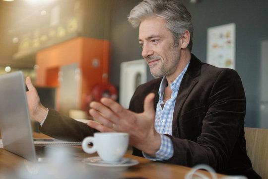 Mature salesman preparing sales pitch