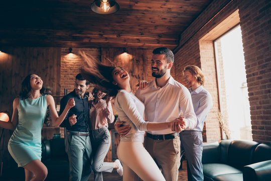 Close up photo love lovers classy best friends gathering hang out slow dance partners tango she her ladies hair volume flight he him his guys wear dress shirts formal wear sit sofa loft room indoors