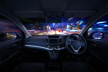 Modern black car dashboard interior with moving motion blur street background, luxury car interior concept .
