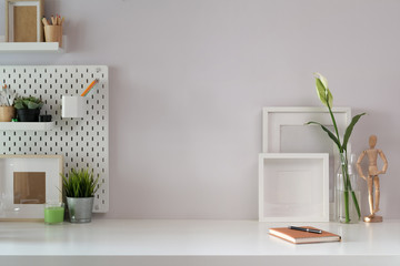 Workspace mock up poster and office accessories with copy space