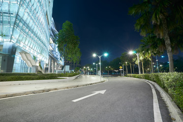 Empty one direction asphalt with modern office building , night scene .