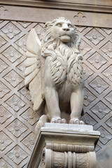 The winged Lion symbol of St. Mark the Evangelist, statue on the facade of Saint Augustine church in Paris, France