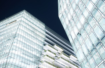 Low angle perspective composition modern commercial building exterior .