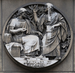 Asclepiade and Lucrece, Greek medicine in Rome. Stone relief at the building of the Faculte de Medicine Paris, France