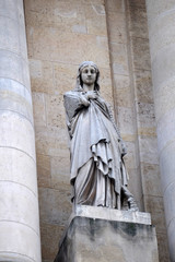 Saint Genevieve, statue on the portal of Saint Roch church in Paris, France