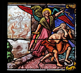 Expulsion from Paradise, stained glass window in Church of Saint Leu Saint Gilles in Paris, France