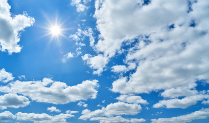 Blue sky with sun and white clouds