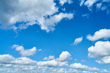 Blue sky with white clouds as a background