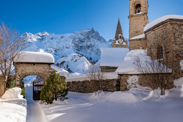 La Grave, Hautes-Alpes, Ecrins National Park, France: The local village of La Grave and its church with La Meije mountain peak in Winter
