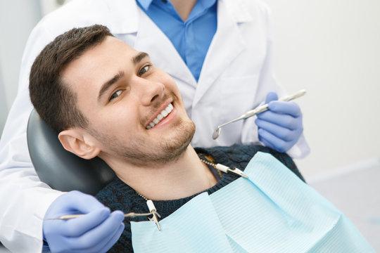 Young man visiting dentist at the clinic
