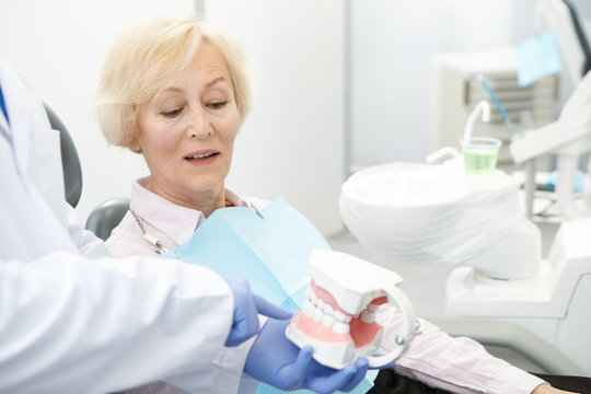 Professional dentist and his senior patient