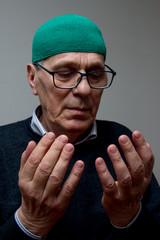 Elderly muslim man praying