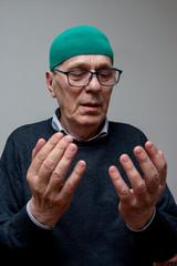 Elderly muslim man praying