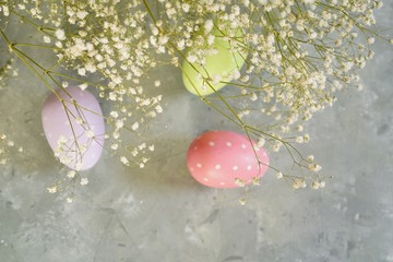 Spring Easter background with floers and eggs, selective focus