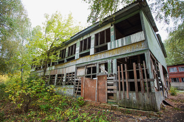 Old abandoned spooky wooden house. Horizontal color photography.