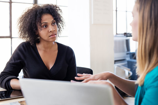 Businesswoman talking with colleague in office