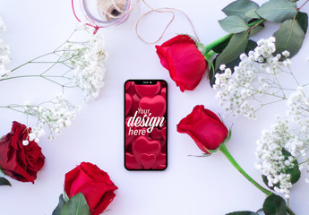 Smartphone on a White Table with Roses Mockup