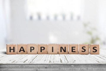 Happiness sign made of wood in a bright living room