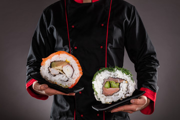 Printed roller blinds Sushi bar Chef holding plates with sushi pieces.
