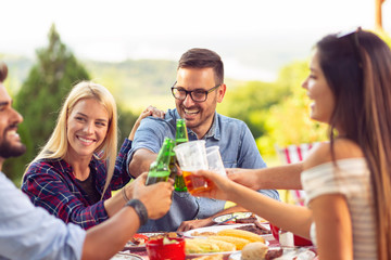 People drinking beer at barbecue party