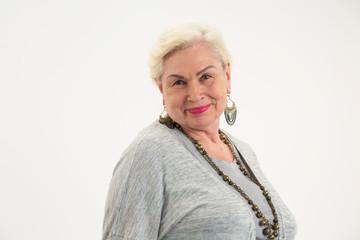 Isolated elderly woman. Senior lady smiling. Confidence and optimism.