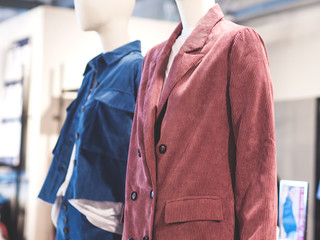 White mannequins wearing jackets