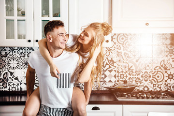 Young couple lifestyle moments at the kitchen