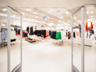 Abstract blurred entrance area of cloth store as background. Clothes shop blur